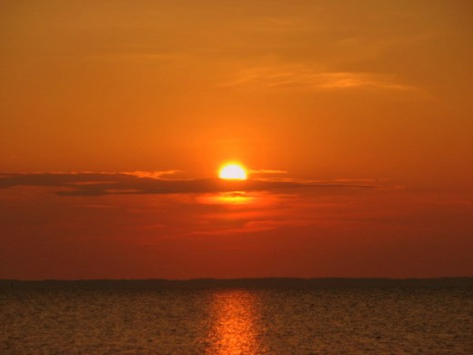 The sun sets over the beautiful Chesapeake Bay, just off of Saxis Island, Virginia. Saxis Island is located on the bayside of the Eastern Shore of Virginia.