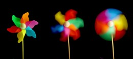 Shutter Speed.. in all three images, the pinwheel was spinning at about the same speed. The difference in the camera shutter speed causes different results.