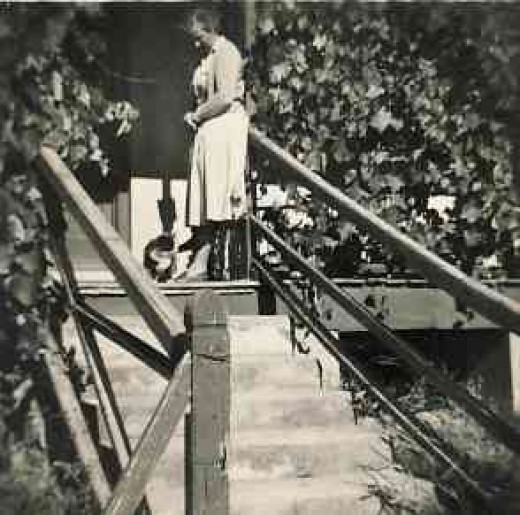 My mother with our cat Freddy on the verandah of the first house I remember in Blythswood