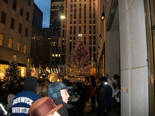 Street filled with lit up angels headed towards the Christmas Tree at Rockefeller Center.