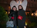 A picture of me and my mom behind a lit angel.