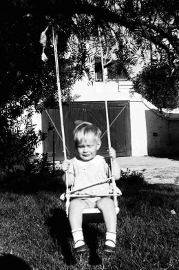 Me on the swing at the back of Queenie's house.