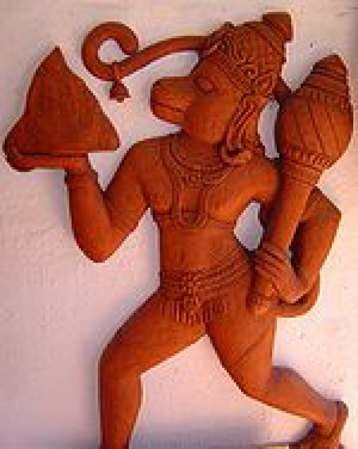 A picture of Hanuman holding an Indian Gada