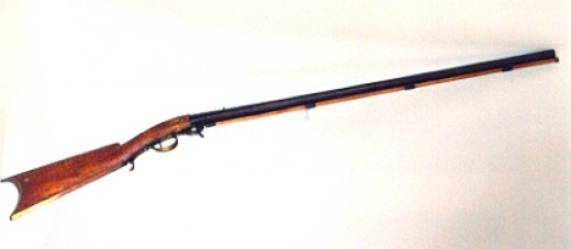 This underhammer smooth-bore rifle was made using a barrel from a Springfield rifle that didn't pass government inspection.  Guns like this are what the '49ers carried to California.