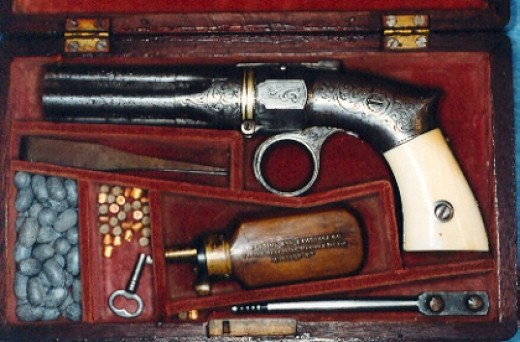 The deluxe pistol came with nickel plating, was elaborately engraved, and had ivory hand grips.  It was sold in a wooden case.