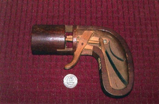 The wooden patent model for the original Leonard pistol shows the springs and trigger mechanism.