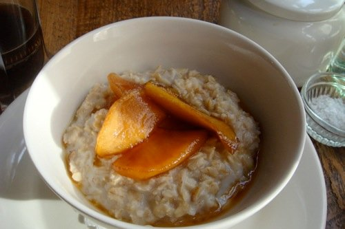 Joseph Leonard'oatmeal, excellent, cooked with just enough milk and spread with apples caramelized so deeply they fall apart and dissolve. [Photo: Carey Jones]