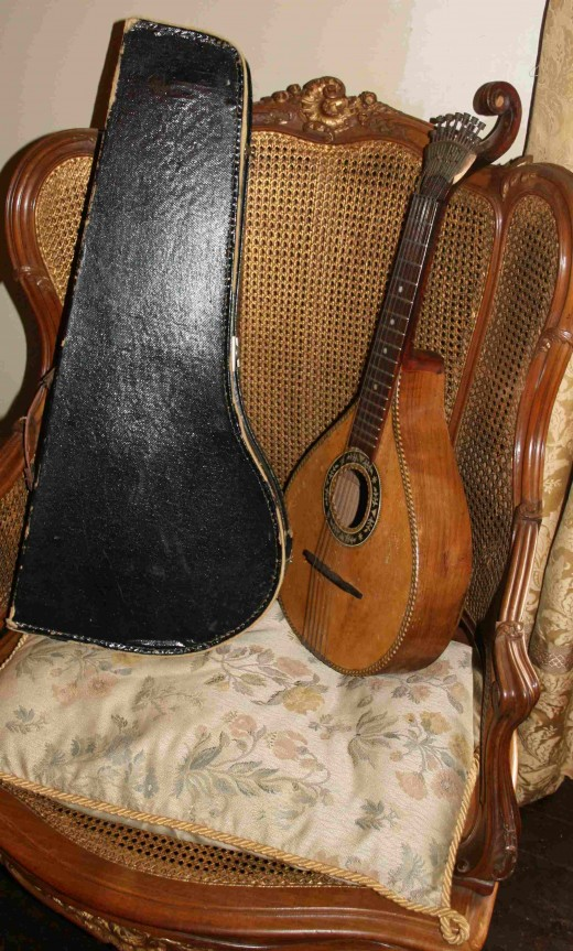 Mandolin and case on a chair in the music room