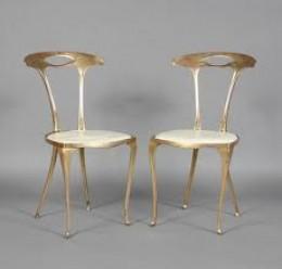Slender and elegant gilt Italian side chairs