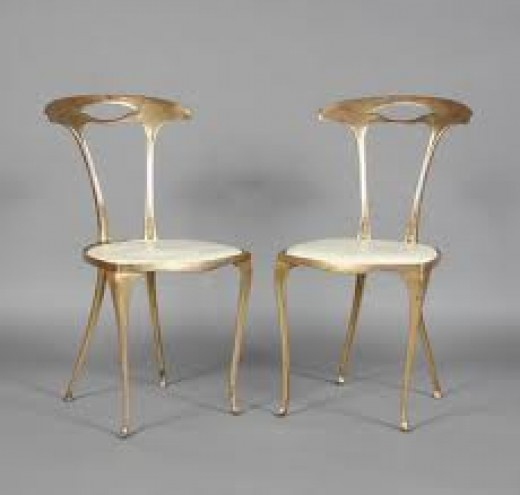 Slender and elegant gilt Italian side chairs
