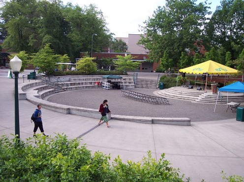 The amphitheatre on the University of Oregon campus, where On the Rocks practices every Friday, sometimes in the rain. Many people gather to enjoy the practice.