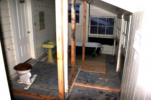 "View into bath - removed wall separating the ""mud room"" from the original bath to double the size of the bathroom"