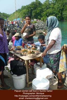 Women sell food at the harbor of Numfor island