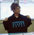 Sarah Palin holding a T-shirt related to the Gravina Island Bridge