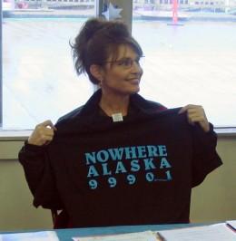 Sarah Palin holding a T-shirt related to the Gravina Island Bridge