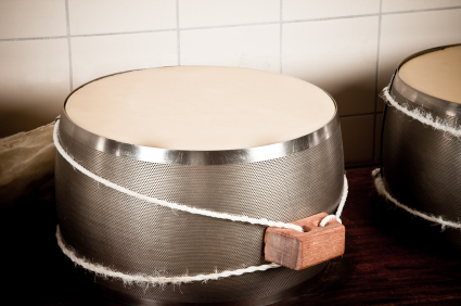 Cheese in a stainless steel matrix band.   Image:  iStockphoto.com/piccerella