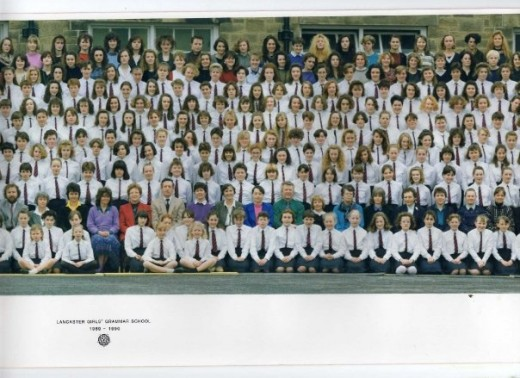 Once every so often we had a whole-school-photo taken.  I am in the fourth row (if you don't include those four girls at sitting at the front as the first row), eighth girl in, two above the teacher in the purple jumper and white collar.