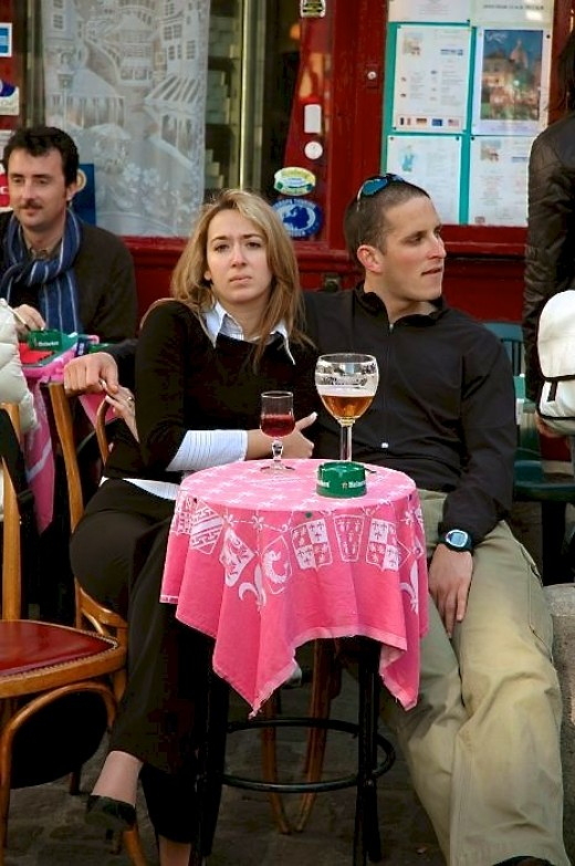 A pair of lovers 'enjoy' the Paris cafe scene.