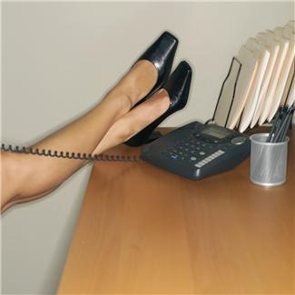 womens feet shoes on desk