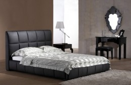 The Emile platform bed features a frame upholstered with stylish leather.