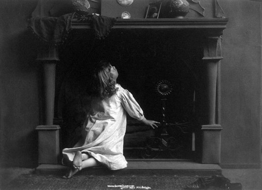 From the Library of Congress, c1900. Image of girl looking up the fireplace.