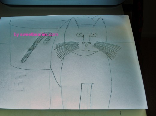 Here is the outline drawing for my cat Christmas card sketch, which I drew on a sheet of recycled paper.