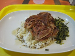 Stewed pork over rice with pickled cabbage