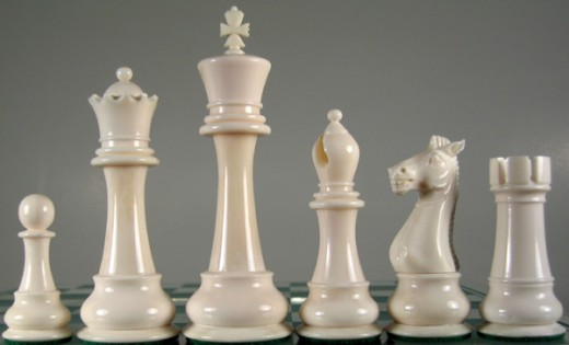 Starting from the right hand side, pawn, queen, king, bishop, knight, rook.
