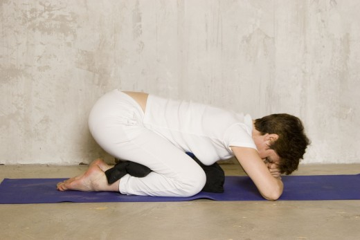 Support child pose with bolster, cushion or rolled blankets under thighs and ankles if needed.  Spending a few minutes in this position before bed is a natural sleep aid.