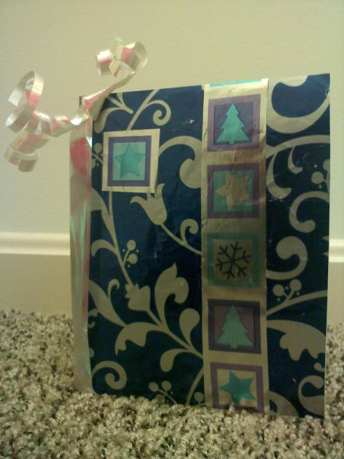 Here is the front of my example. I used spray adhesive and two wrapping papers with a blue palette.