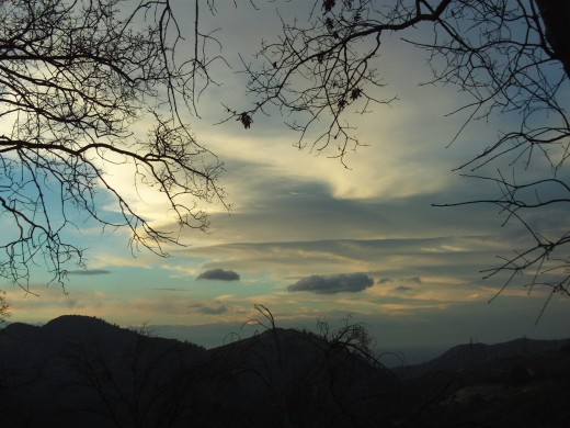 Clouds with orange and bluish colors in the sky on a late afternoon in the Lake Arrowhead vicinity.