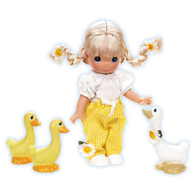 There's no denying that this little miss is for the birds! Daisy bedecked sweetheart seems to radiate sunshine as she naturally attracts a trio of feathered friends to her side. Vinyl 9 inch doll.