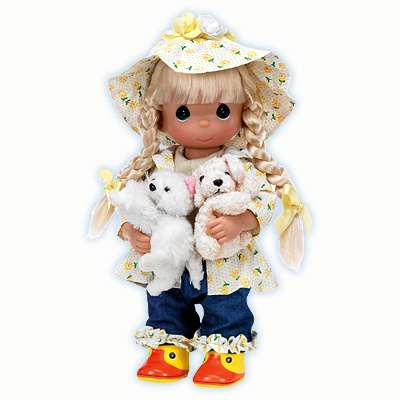 "It's lucky this little miss is dressed for April showers since she's got a pair of pretty plush pets to keep dry and warm. She's all abloom in a blossom bedecked rain hat, rain coat and rubbery duck boots. Vinyl 12""H doll."