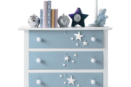 Transform an old brown dresser into a darling piece of furniture for your child's bedroom