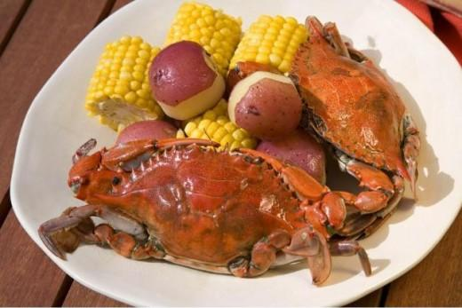 Blue Crabs And Corn go together so well. The flavor is just amazing. You can steam blue crabs , potatoes , and corn on the cob in old bay seasoning for a delicious meal.