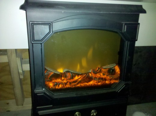 Keeps me warm under my station. Nothing like a fake fireplace!