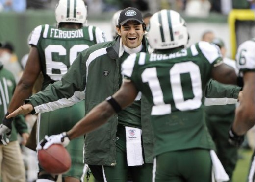 New York Jets' Santonio Holmes, right, celebrates with quarterback Mark Sanchez after scoring a touchdown during the second quarter of an NFL football game against the Buffalo Bills at New Meadowlands Stadium, Sunday, Jan. 2, 2011, in East Rutherford