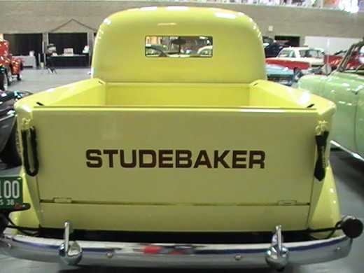 Classics and Chrome Car Show Loves Park Illinois photo of yellow Studebaker truck