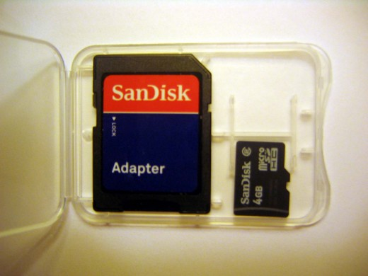 On the right is the micro SD card.  The adapter is on the left is the size of a standard SD card shown for comparison.