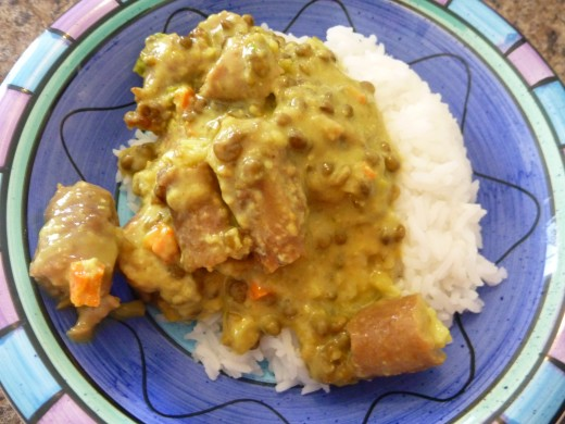 Swiftly prepared Curried Sausages - served on rice - in a funky dish
