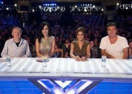 Katy Perry takes her seat alongside Cheryl Cole - both tipped to be judges on the US version.