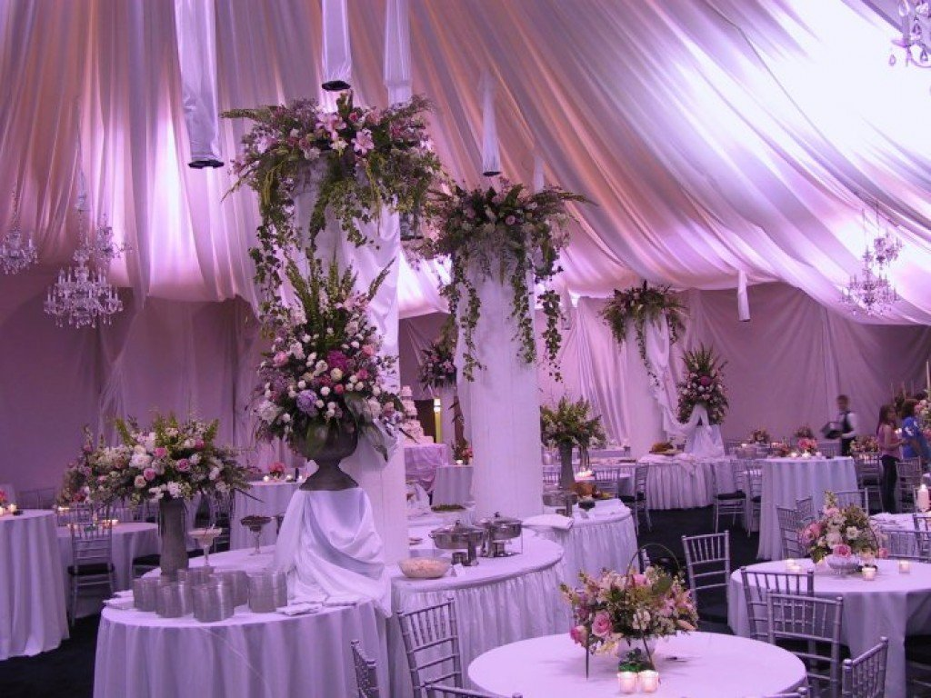 Get inspired by these decked out wedding tents, with hanging lanterns, paper flowers, Edison bulbs, chandeliers, candelabras, garlands, and so much more.