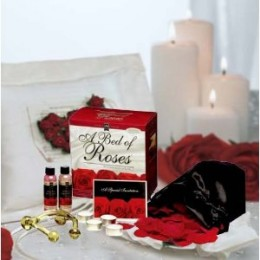 A Bed of Roses - Romantic Gift Basket Offers over 250 scented red silk rose petals and assorted sexy items make up this ultimate romantic gift Basket.
