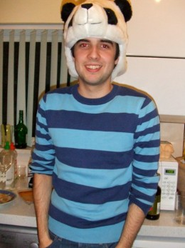 Me with a stripy sweater, panda hat and devil eyes.