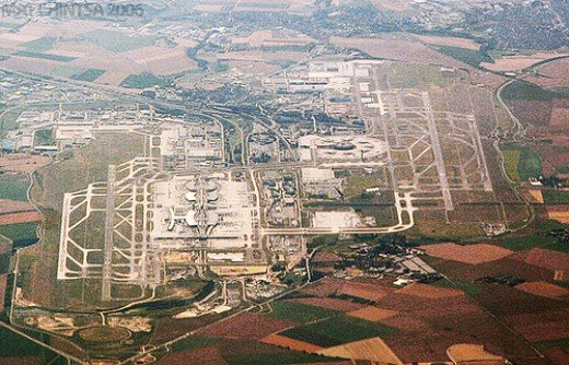 An aerial view of Paris Charles de Gaulle International Airport (CDG/LFPG) as seen from a British Airways Airbus A320-200 heading to London Heathrow (LHR/EGLL) from Athens Eleftherios Venizelos (ATH/LGAV) in July 2006.