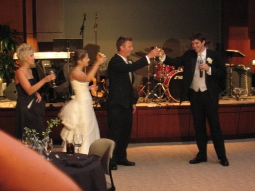 That's me on the right, in my new favorite picture, at Edie and Nico's wedding a couple weeks back.  It was an honor to give a toast to two of my greatest friends and the creators of the Indie Christmas CD!