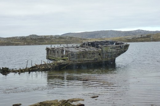 An old ship left rotting in the harbour.
