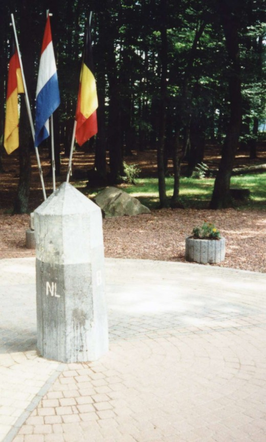 Here at Germany's Dreilaendereck, the borders of three countries meet. Flags depicted, from left to right, are: German, Dutch and Belgian