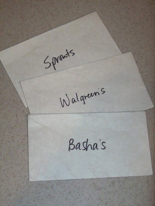 I keep a labeled envelope for each grocery store in my box