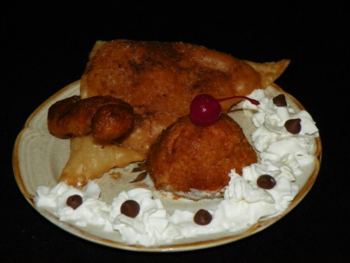 "I incorporate Bread Stick Churro, a Sopapilla and Fried Ice Cream to make this dish. I named this scene ""Eve's temptation"" as the ""serpent"" Churro seems to offer up the ""apple"" cherry."